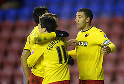 Watford's Troy Deeney celebrates with his team-mates after scoring the first goal - Photo mandatory by-line: Richard Martin-Roberts/JMP - Mobile: 07966 386802 - 17/03/2015 - SPORT - Football - Wigan - DW Stadium - Wigan Athletic  v Watford - Sky Bet Championship