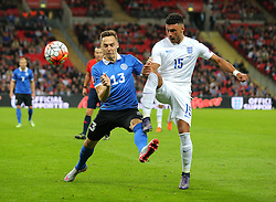 Alex Oxlade-Chamberlain of England of England and Siim Luts of Estonia challenge for the ball - Mandatory byline: Paul Terry/JMP - 07966 386802 - 09/10/2015 - FOOTBALL - Wembley Stadium - London, England - England v Estonia - European Championship Qualifying - Group E