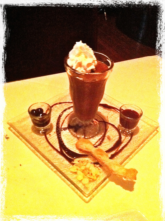 chocolate mousse with whip cream,in tall soad glass,on yellow table cellphone photography,Iphone pictures,smartphone pictures