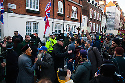 "Mayfair, London, November 28th 2014. A protest against Egypt's leader Al-Sisi descended into moinor scuffles as right wing ""patriots"" from anti-Islamic group Britain First arrived to protest against the presence of Islamist preacher Anjem Choudary, who was recently arrestred as part of an ant-terror operation. Playing patriotic British Music, Britain First accused Muslims of worshiping a ""devil"" and a ""paedophile prophet"". Police had to intervene before hotheads on both sides became violent. PICTURED: Britain First Ant-Islamists on the left are kept apart from the Muslim anti-Sisi protesters."