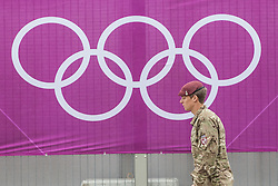 © licensed to London News Pictures. London, UK 20/07/2012. A soldier walking between entrances of the Olympic site on 20/07/12. Photo credit: Tolga Akmen/LNP