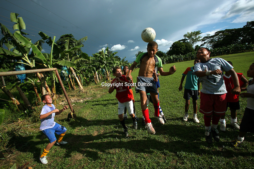 Young boys play a game of soccer on a field carved out of a banana plantation just outside of Apartado, in the heart of Colombia?s banana growing region, on July 11, 2007. Colombia?s banana region has long a stronghold for illegal armed groups who apparently funded their wars by taxing the banana industry. American banana executives of the Cincinnati-based fruit giant Chiquita have acknowledged making monthly protection payments for six years to illegal groups that killed thousands of people. (Photo/Scott Dalton)