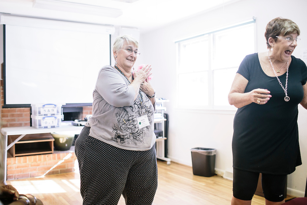 9/22/2014. FAIRFAX, VIRGINIA. Wendy Campbell improvs a scene with a piece of pink tissue paper during OLLI player workshop drama class at Osher Lifelong Learning Institute in Fairfax, Va. Campbell, a former teacher, has found a new passion for acting through these classes.