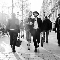 "Two men share a conversation while walking along the Avenue des Champs-Élysées in Paris, France, in April of 2015. The Avenue des Champs-Élysées is a boulevard in the 8th arrondissement of Paris that runs 1.2 miles long and connects the Place de la Concorde and the Place Charles de Gaulle, where the Arc de Triomphe is located. It is known for its theatres, cafés and luxury shops, and for the military parade that takes place each year on the avenue on 14 July to celebrate Bastille Day. The name is French for the Elysian Fields, the paradise for dead heroes in Greek mythology. The French proudly nickname this world-famous avenue ""la plus belle avenue du monde"" (""the world's most beautiful avenue"")."