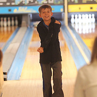 Clayton Russell, 11, of Mooreville, reacts to a missed pin while bowling as he turns to his mom Amanda and his sister Adison as they have time out of the house from the winter weather with an afternoon of fun at Rebel Lanes Wednesday afternoon in Tupelo.