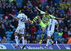Yeovil Town's Edward Upson jumps against Leeds United's Scott Wootton-Photo mandatory by-line: Matt Bunn/JMP - Tel: Mobile: 07966 386802 02/11/2013 - SPORT - FOOTBALL - Elland Road - Leeds - Leeds United v Yeovil Town - Sky Bet Championship