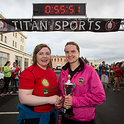 25.08. 2017.                                                      <br /> Almost 200 UL Hospitals Group staff, past and present, and members of the public completed the annual 5k Charity Run/Walk on Friday August 25th in Limerick.<br /> <br /> Josephine Hynes, UHL Group HR Director presents the 3rd place women's trophy to Aisling Ahern, An Bru A.C.<br /> <br /> <br /> Everybody who participated also raised funds for Friends of Ghana, an NGO formed last year by UL Hospitals Group and its academic partner the University of Limerick to deliver medical training programmes in the remote Upper West Region of Ghana. Picture: Alan Place