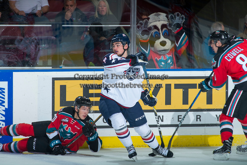KELOWNA, CANADA - OCTOBER 27: Anthony Bishop #7 of the Tri-City Americans checks Conner Bruggen-Cate #20 of the Kelowna Rockets during first period on October 27, 2017 at Prospera Place in Kelowna, British Columbia, Canada.  (Photo by Marissa Baecker/Shoot the Breeze)  *** Local Caption ***