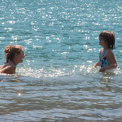 Olivia and Eliza Swimming in Diablo Lake, North Cascades National Park, Washington, US
