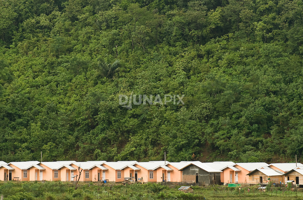 Little pink houses constucted for tsunami survivors south of Leupeng, Aceh