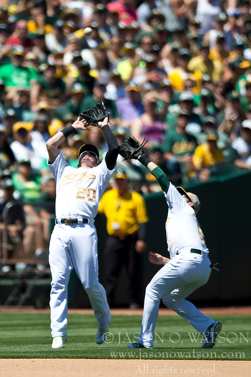 OAKLAND, CA - MAY 26:  Josh Donaldson #20 of the Oakland Athletics catches a fly ball hit off the bat of Bryan Holaday #50 of the Detroit Tigers (not pictured) in front of Jed Lowrie #8 during the fourth inning at O.co Coliseum on May 26, 2014 in Oakland, California. (Photo by Jason O. Watson/Getty Images) *** Local Caption *** Josh Donaldson; Jed Lowrie