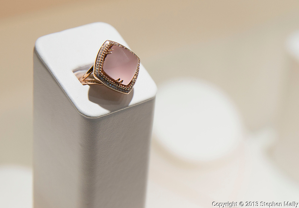 A rose gold custom ring with diamonds and a cabochon frosted rose quartz at Karen Marie Jewelers in Cedar Rapids on Tuesday, January 29, 2013.