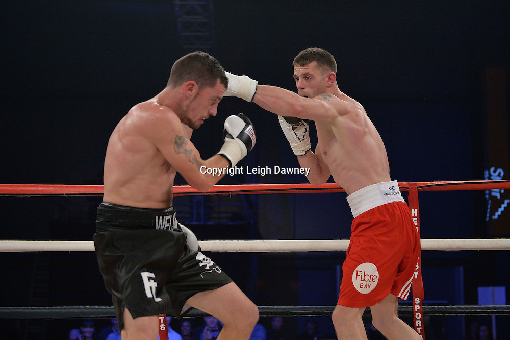 Martin Welsh (black shorts) defeats Tommy Broadbent in a middleweight boxing contest at Glow, Bluewater, Kent on the 8th November 2014. Promoter: Hennessy Sports. © Leigh Dawney Photography 2014.