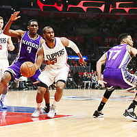 26 March 2016: LA Clippers guard Chris Paul (3) drives past Sacramento Kings guard Langston Galloway (9) and Sacramento Kings guard Garrett Temple (17) during the Sacramento Kings 98-97 victory over the Los Angeles Clippers, at the Staples Center, Los Angeles, California, USA.