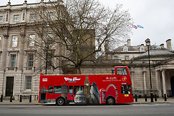 An empty tour bus on Whitehall in London. <br /> <br /> Some parts of central London are being left unusually quiet at times as consideration is given to social distancing during the COVID-19 pandemic.