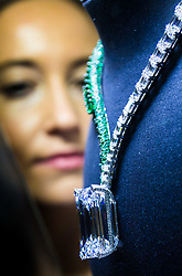 Christie's, London, October 03 2017. A woman admires a 404 carat-rough diamond, discovered in early 2016 that has been transformed by de GRISOGONO in Geneva by a team of 14 craftsmen who worked for over 1,700 hours to create a spectacular necklace mounting, the largest, flawless, D-colour diamond ever to come to auction, expected to fetch in the region of US$30 Million.<br />  <br /> Christie's will offer the diamond at its sale of Magnificent Jewels on 14 November in Geneva. The necklace represents a celebration of THE ART OF de GRISOGONO on the eve of the company's 25th anniversary and is on public preview  at Christie's in London from 3-7 October 2017. © Paul Davey