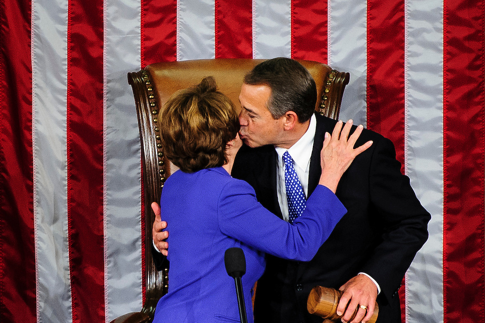 Rep. John Boehner (R-OH) kisses Rep. Nancy Pelosi (D-CA) after being elected to a second term as Speaker of the House with 220 votes at the U.S. Capitol in Washington, District of Columbia, U.S., on Thursday, Jan. 3, 2013. Twelve GOP lawmakers either opposed him, voted present or abstained. The 133th Congress begins Thursday with the swearing in of newly elected Members of Congress and the election of the Speaker of the House of Representatives. Photographer: Pete Marovich/Bloomberg