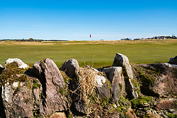 Stone wall on boundary of Muirfield Golf Course in Gullane, East Lothian, Scotland, United Kingdom