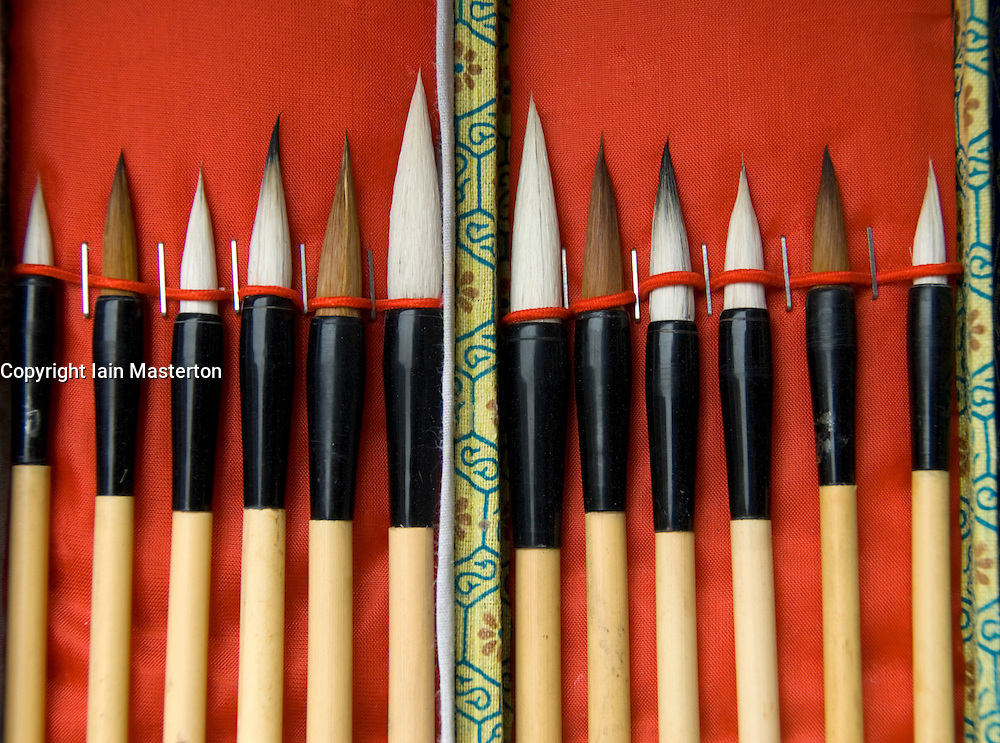 Box of paint brushes for calligraphy at famous Liulichang antiques street in Beijing China