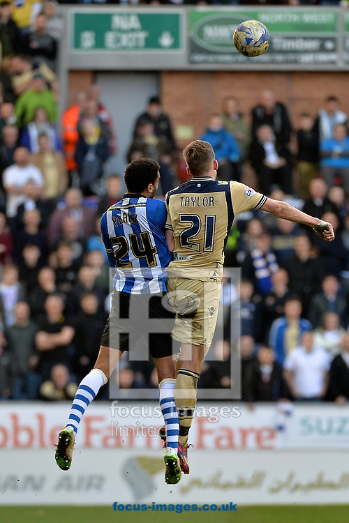 James Perch of Wigan Athletic (left) and Charlie Taylor of Leeds United (right) during the Sky Bet Championship match at the DW Stadium, Wigan<br /> Picture by Ian Wadkins/Focus Images Ltd +44 7877 568959<br /> 07/03/2015