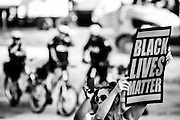 A protester raises a sign of 'Black Lives Matter' during a 2015 action by Black Lives Matter Toronto.
