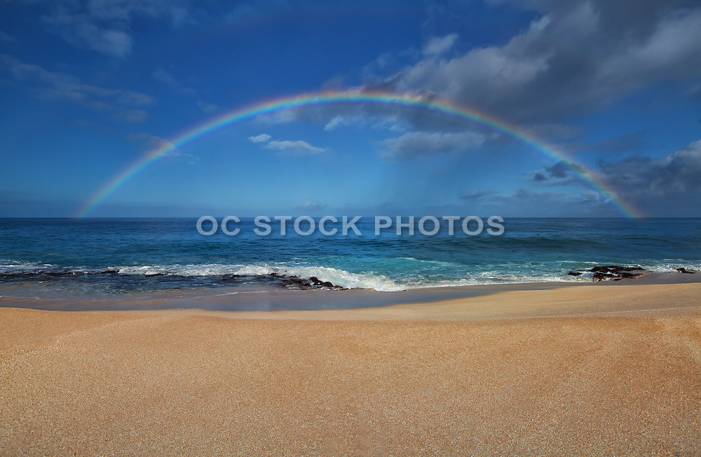 Rainbow Over the Pacific Ocean and the Beach
