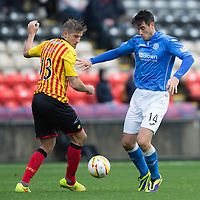 Partick Thistle v St Johnstone....25.10.14   SPFL<br /> Brian Graham is closed down by Frederic Frans<br /> Picture by Graeme Hart.<br /> Copyright Perthshire Picture Agency<br /> Tel: 01738 623350  Mobile: 07990 594431
