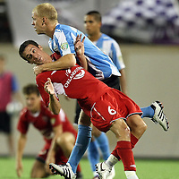 Orlando City Lions Defenseman Jack Traynor (6) gets fouled by Wilmington player Luke Mulholland (8) during a United Soccer League Pro soccer match between the Wilmington Hammerheads and the Orlando City Lions at the Florida Citrus Bowl on June 18, 2011 in Orlando, Florida.  (AP Photo/Alex Menendez)