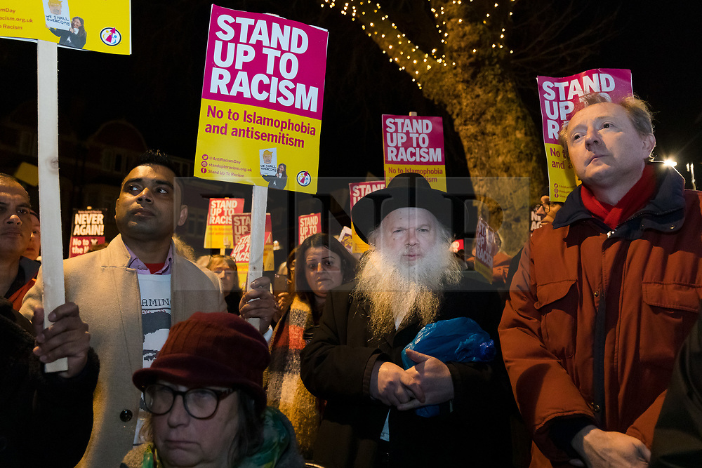 © Licensed to London News Pictures. 30/12/2019. London, UK. Rabbi Herschel Gluck (C) joins people to take part in a protest vigil against anti-semitic graffiti in Hampstead and Belsize Park, held in Rosslyn Hill in Hampstead. Yesterday, anti-semitic graffiti was daubed on a synagogue and several shops in north London during the Jewish festival of Hanukkah. Photo credit: Vickie Flores/LNP