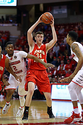 26 November 2016:  Cole Walker plays post and screen to rid Markese Mayfield of DJ Clayton(2) during an NCAA  mens basketball game between the Ferris State Bulldogs the Illinois State Redbirds in a non-conference game at Redbird Arena, Normal IL