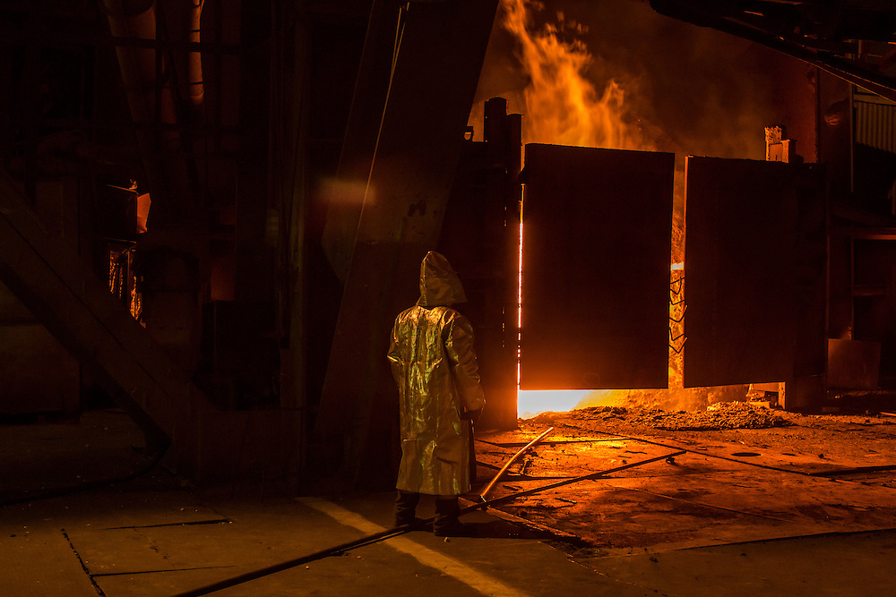A worker tends the converter at the Azovstal Iron and Steel Works on Friday, March 18, 2016 in Mariupol, Ukraine.