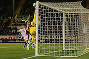 Burnley goalkeeper Thomas Heaton keeps a last minute shot from Milton Keynes Dons midfielder Carl Baker out  during the Sky Bet Championship match between Burnley and Milton Keynes Dons at Turf Moor, Burnley, England on 15 September 2015. Photo by Simon Davies.