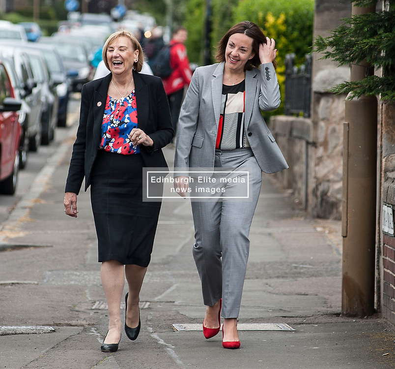 Scottish Labour leader Kezia Dugdale arrives to cast her vote in the general election at her local polling station in Lochend, Edinburgh with local councillor Joan Griffiths.<br /> <br /> © Dave Johnston/ EEm