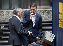 © Licensed to London News Pictures. 13/07/2017. London, UK. Chris Gard (R) talks with an advisor outside court after leaving the court during proceedings. The parents of terminally ill Charlie Gard have returned to the High Court in light of new evidence relating to potential treatment for their son's condition. An earlier lengthy legal battle ruled that Charlie could not be taken to the US for experimental treatment. London, UK. Photo credit: Peter Macdiarmid/LNP