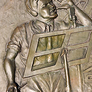 "1938 Martian Site Landing Monument. Detail of Orson Welles figure at microphone.......Monument commemorates Orson Welles' famous broadcast of a radio adaptation of H.G.Wells' ""War of the Worlds"" in which a Martian invasion force landed at Grovers Mill, New Jersey. The broadcast was initially believed to be true by many."