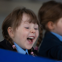 A happy Sophie Buckley finds something amusing on her First day at school in Liscannor