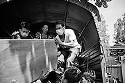 At Calmette Hospital in Phnom Penh, Cambodia, friends and family members load the coffin of a female victim onto a goverment truck for transport to her hometown.  Several hundred perished in a stampede tragedy when an unknown event sparked panic and thousands attempted to flee Diamond Island in the middle of the Mekong River over the bridge connecting it to the river bank.