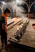 Men perform the nightly Hindu Puja Rituals in Varanasi, Uttar Pradesh, India