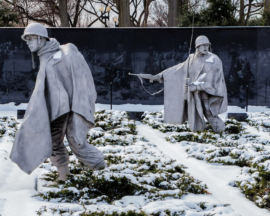 The Korean War Memorial never looks more somber than in winter, where these nameless heroes trudge through Earth and snow.
