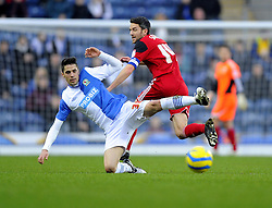Bristol City's Cole Skuse tackles Blackburn Rovers' Diogo Rosado - Photo mandatory by-line: Joe Meredith/JMP  - Tel: Mobile:07966 386802 05/01/2013 - Blackburn Rovers v Bristol City - SPORT - FOOTBALL - FA Cup -  BLACKBURN - EWOOD PARK -