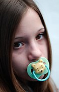Girl with a dummy in her mouth