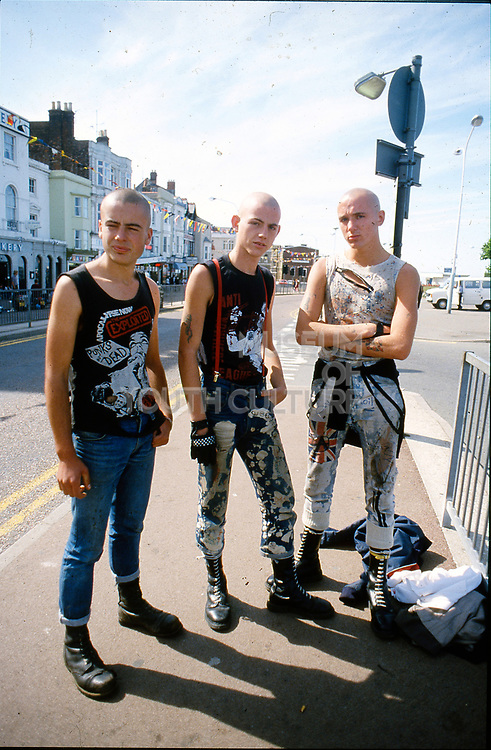 Three skinheads in Brighton, UK, 1980s.