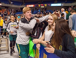 Huntington players celebrate winning the Class AAA championship game at the Charleston Civic Center.