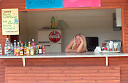 Woman age 20 working at outdoor concession stand.  Chechocinek Poland