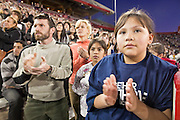 obamatucson 12 JANUARY 2011 - TUCSON, AZ: Yamileth Estrada (CQ)10, strains to hear the President in the University of Arizona stadium Wednesday when it was used for overflow seating during the Together We Thrive Tucson & America event on University of Arizona campus. Tens of thousands of people filed into the stadium to hear President Obama speak. The service is for the victims of Saturday's mass shooting at a Safeway in Tucson.        ARIZONA REPUBLIC PHOTO BY JACK KURTZ..Gabrielle Giffords shooting, mass shooting,