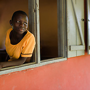 Grace (13), pictured on 15 May 2014, is in Form 1 in the Volta Region of Ghana. She says science is her favourite subject, because it allows her to learn about the human body. As her school has neither water nor sanitary facilites, she and her fellow students take turns to bring water to school. When it is her turn, she carries a bucket of water on the 30 minute walk from her home to school. If the water runs out, which happen frequently, she may have to go home to get more, which may mean missing class.