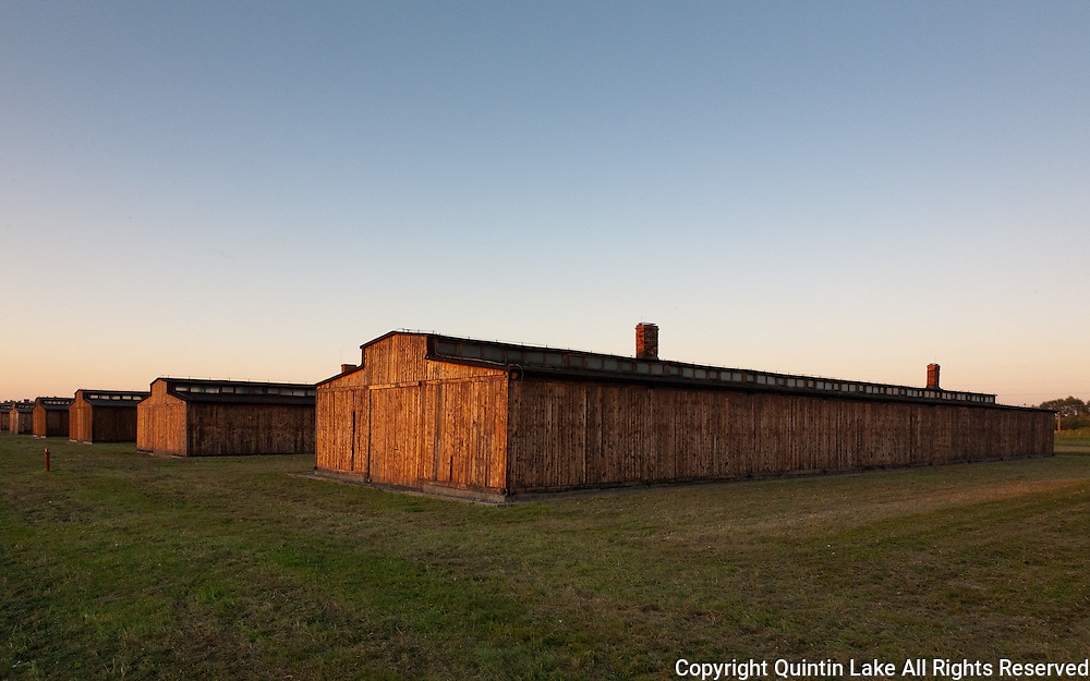 """Wooden barracks in Auschwitz II- Birkenau. These barracks were actually prefabricated horse stables originally made for use on the eastern Front, against the Soviet Union. Even the rings for tying horses were in place along the sides. The wooden bunks, or """"hutches"""" as they are sometimes called, contained as many as six prisoners on each shelf. Originally intended to house 250 prisoners, these barracks sometimes contained as many as a thousand.Auschwitz II-Birkenau Extermination Camp (Poland)"""