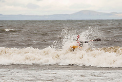 A lone kayaker heads into the waves, literally, at Portobello beach, Edinburgh this afternoon. A metaphor for Brexit?<br /> © Jon Davey/ EEm