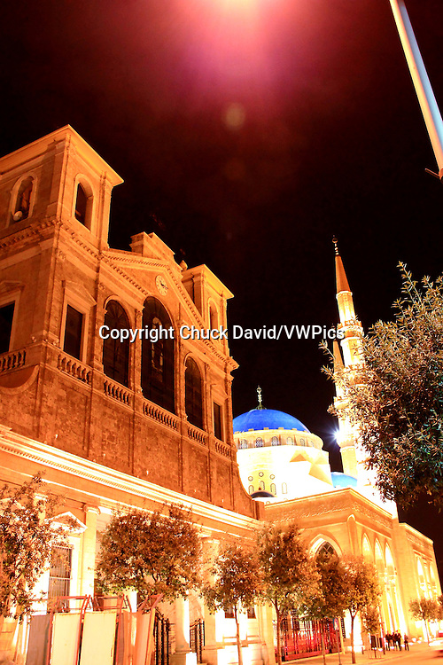 A church boasts classical architecture against the backdrop of the modernly styled Al Amin mosque in Centre Ville, Beirut, Lebanon.