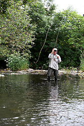 UK ENGLAND ENGLAND SHROPSHIRE LLANYBLODWEL 1JUL15 - Angler Robert Park practices fly fishing in the river Tanat in Llanyblodwel, part of the river Severn catchment area.<br /> <br /> jre/Photo by Jiri Rezac / WWF UK<br /> <br /> © Jiri Rezac 2015